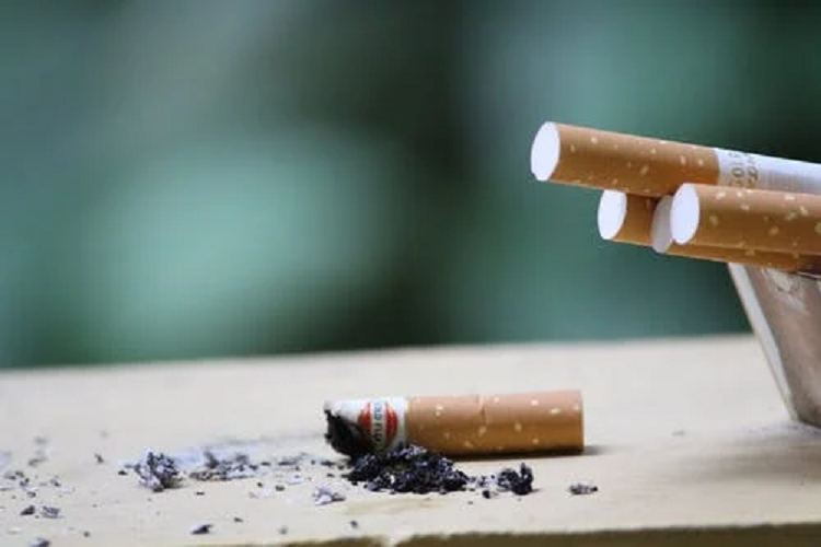 Cigarettes and cigarettes butt with ashes