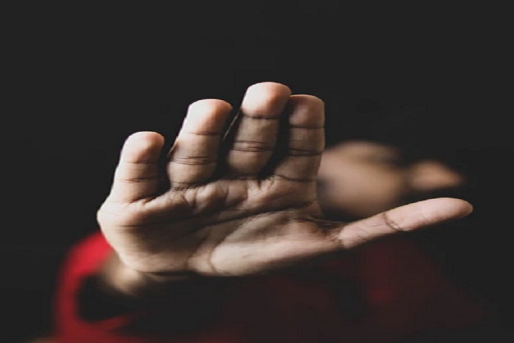 A person showing hand as sign of no